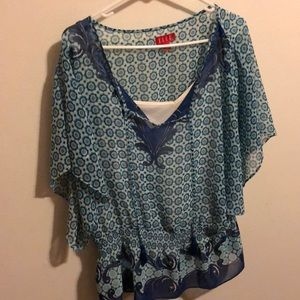 Blouse with tank built in